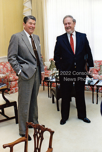 United States President Ronald Reagan, left, talks with Judge Robert H. Bork, his nominee for Associate Justice of the U.S. Supreme Court to replace Justice Lewis Powell, right, in the Residence of the White House in Washington, D.C. on October 9, 1987. .Mandatory Credit: Pete Souza / White House via CNP