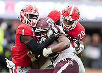ATHENS, GA - NOVEMBER 23: Divaad Wilson #1 and J.R. Reed #20 of the Georgia Bulldogs tackle Reese Mason #20 of the Texas A