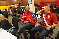 San Francisco, CA - Tuesday, July 1, 2014:  After the game, soccer fanatics Zack Phillips, and wife June Solomon, dealt with the defeat. Employees at Arthur J. Gallagher insurance company took over a small meeting room to watch the USA vs. Belgium World Cup Round of 16 game in San Francisco.