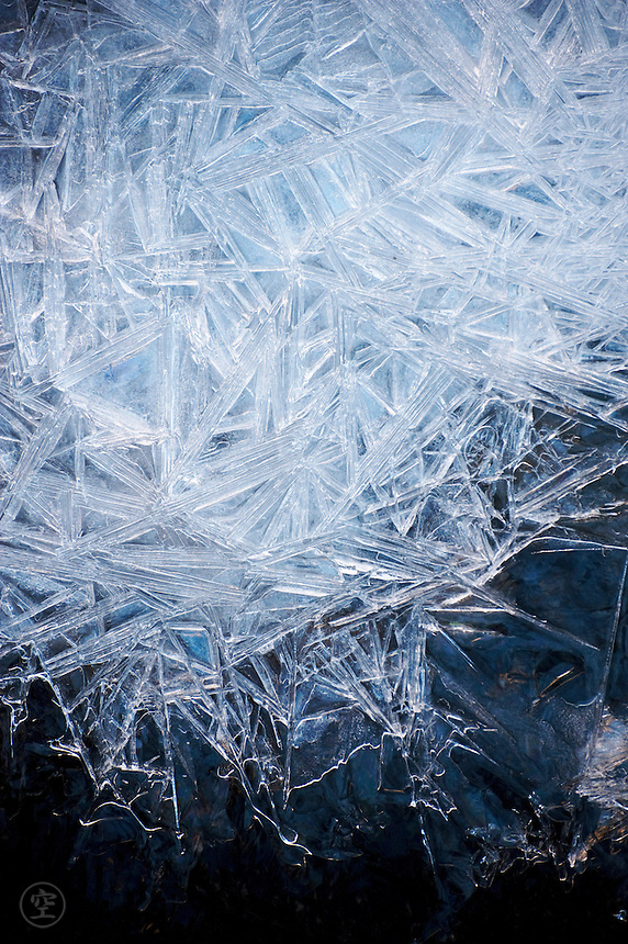 Ice crystals make a wintry blue abstract.