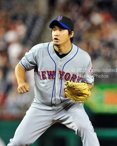 New York Mets pitcher Ryota Igarashi (18) watches as Washington Nationals third baseman Ryan Zimmerman connects for a walk-off sacrifice fly in the ninth inning at Nationals Park in Washington, D.C. on Thursday, July 1, 2010.  The Nationals won 2 - 1..Credit: Ron Sachs / CNP.(RESTRICTION: NO New York or New Jersey Newspapers or newspapers within a 75 mile radius of New York City)