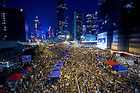 HONG KONG, HONG KONG SAR, CHINA - OCTOBER 04: The crowd of protesters in 'Occupy Central' camp in Admirality, Hong Kong, on October 4, 2014. The 'Umbrella revolution' or 'Occupy Central' is a civil disobedience movement that began in response to China's decision to allow only Beijing-vetted candidates to stand in the city's 2017 election for the top civil position of chief executive. Thousands of pro-democracy supporters are calling for open elections and the resignation of Hong Kong's Chief Executive Leung Chun-ying. (Photo by Lucas Schifres/Getty Images)