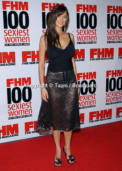 "Catherine Bell arriving at the ""  FHM - Sexist Party of The Year "" at the Raleigh Studios in Los Angeles. June 5, 2003."