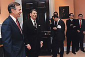 United States President Ronald Reagan, center left, and US President Elect George H.W. Bush say thank you to Senior Staff Members on January 19, 1989, the day before Bush will be inaugurated as the 41st President of the United States, including Chief of Staff Ken Duberstein, Second from right, and new Chief of Staff John Sununu, right, in the Roosevelt Room of the White House in Washington, DC.  <br /> Mandatory Credit: Susan Biddle / White House via CNP