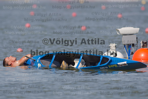 Chirila Iosif from Roumania takes a bath after the C1 men canoe 1000m semi-final during the 2011 ICF World Canoe Sprint Championships held in Szeged, Hungary. Thursday, 18. August 2011. ATTILA VOLGYI