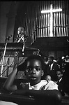 Rachel West in foreground as Dr. Martin Luther King Jr speaks from pulpit of Browns Chapel, Selma Ala. This and over 10,000 other images are part of the Jim Peppler Collection at The Alabama Department of Archives and History:  http://digital.archives.alabama.gov/cdm4/peppler.php