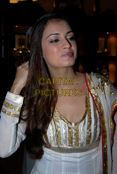 DIA MIRZA.At the opening of the Middle East International Film Festival (MEIFF) in Abu Dhabi, United Arab Emirates..October 14th, 2007.half length white gold dress sequins sequined hand.CAP/IA.©Ian Allis/Capital Pictures