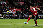 John Egan of Sheffield United shoots at goal during the Premier League match at Bramall Lane, Sheffield. Picture date: 5th December 2019. Picture credit should read: James Wilson/Sportimage