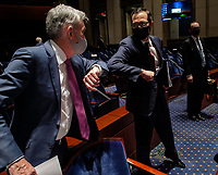 Jerome H. Powell, Chair of the Board of Governors of the Federal Reserve System, left, and United States Secretary of the Treasury Steven T. Mnuchin bump elbows at the conclusion of the US House Committee on Financial Services hearing on Oversight of the Treasury Department and Fed Reserve Pandemic response in Washington, DC on June 30. <br /> Credit: Bill O'Leary / Pool via CNP /MediaPunch