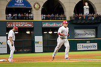 Philadelphia Phillies catcher Carlos Ruiz #51 heads home after hitting a ninth inning home run during the Major League Baseball game against the Houston Astros at Minute Maid Park in Houston, Texas on September 13, 2011. Houston defeated Philadelphia 5-2.  (Andrew Woolley/Four Seam Images)