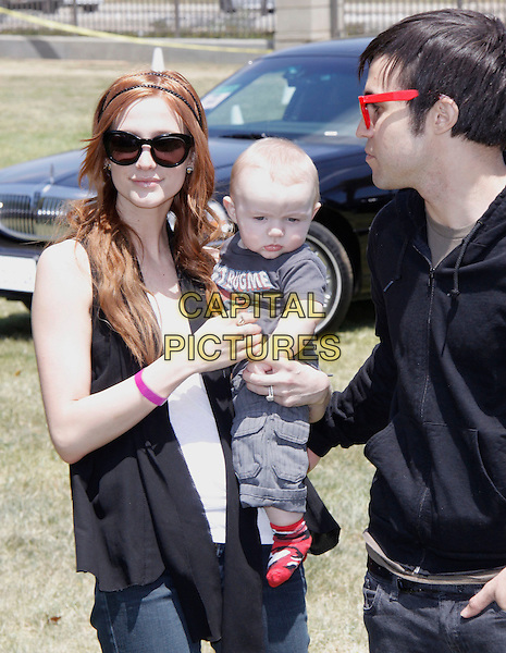 """ASHLEE SIMPSON-WENTZ, BRONX MOWGLI WENTZ & PETE WENTZ.The 20th annual """"A Time for Heroes"""" Celebrity Carnival benefiting Elizabeth Glaser Pediatric AIDS Foundation held at Wadsworth Theater on the Veteran Administration Lawn in West Los Angeles, California, USA. .June 7th, 2009.half length jeans denim grey gray top black sunglasses shades lifting carrying mother mom mum daughter son boots married husband wife father dad.CAP/DVS                                                  .©Debbie VanStory/Capital Pictures."""