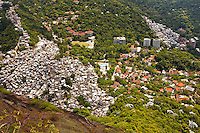 Part of Favela da Rocinha at left, Favela Vila Parque da Cidade in background, high class Gavea neighborhood at right  - both rich and poor houses invading Atlantic Forest - and The Escola Americana do Rio de Janeiro ( American School of Rio de Janeiro ) at center, an English-medium international, private, independent and upper class coeducational day school.