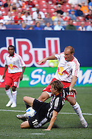 DC United midfielder (16) Brian Carroll and Red Bulls midfielder (13) Clint Mathis become entangled. The New York Red Bulls defaeted D. C. United 1-0 in an MLS regular season match at Giants Stadium, East Rutherford, NJ, on July 22, 2007.