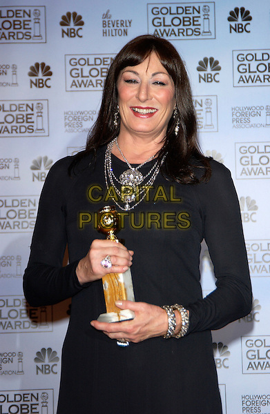 ANJELICA  HUSTON.62nd Annual Golden Globe Awards at The Beverly Hilton Hotel Hotel, Los Angeles, California. Pressroom.January 16th, 2005 .half length, award trophy, necklaces jewellery.www.capitalpictures.com.sales@capitalpictures.com.©Capital Pictures