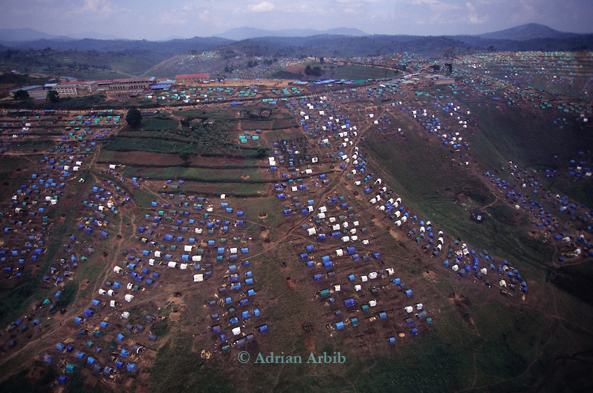 Overspill camp set up close to Kibeho within Rwanda .  Occupied by  Hutus internally displaced  for fear of reprisals from the RPF..
