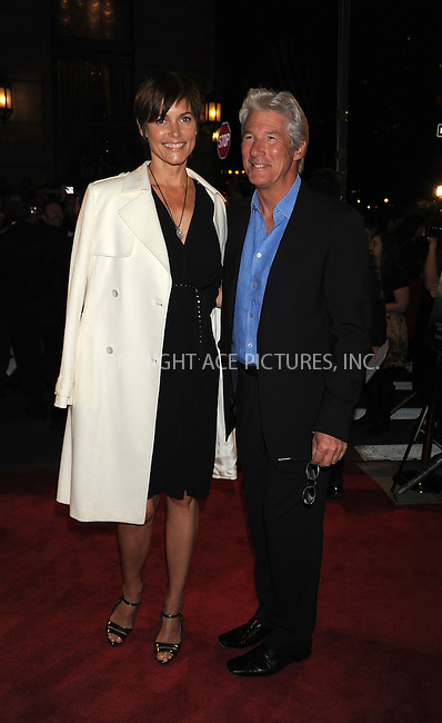 WWW.ACEPIXS.COM . . . . .  ....October 20 2009, New York City....Actress Carey Lowell and actor Richard Gere arriving at the premiere of 'Amelia' at The Paris Theatre on October 20, 2009 in New York City. ....Please byline: AJ Sokalner - ACEPIXS.COM..... *** ***..Ace Pictures, Inc:  ..tel: (212) 243 8787..e-mail: info@acepixs.com..web: http://www.acepixs.com