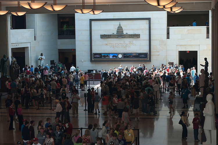 UNITED STATES - : Tourist fill the main hall of the Capitol Visitors Center waiting to start their tours of the U.S> Capitol on June 15, 2011.(Photo By Douglas Graham/Roll Call via Getty Images)