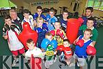 PUT 'EM UP: Members of Ballyduff Boxing Club which is hosting new Boxercise classes for beginners, front l-r: Aidan Whelan, Dylan Brown, Gerard Brown, Niall O'Sullivan. Back l-r: Thomas O'Sullivan, John Regan (Coach), Ryan Whelan, Mark Kepple, Sarah Casey, Sarah Casey, Paul Kepple, Ian Guerin, Jack O'Grady, Frankie O'Brien (Coach), Donnacha Brosnan.