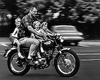 Oakland Raider defensive end Ben Davidson takes his daughters on a ride.  (photo by Ron Riesterer)