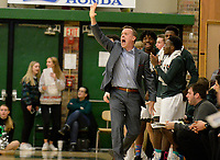 Memorial head coach, Steve Collins, yells to players in the first period, as Middleton takes on Madison Memorial in Wisconsin Big Eight Conference boys basketball on Friday, 12/20/19 at James Madison Memorial High School in Madison