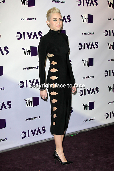 Miley Cyrus (wearing an Omo by Norma Kamali dress, Jean Michel Cazabat shoes, and Lorraine Schwartz jewels) at VH1 Divas 2012 at The Shrine Auditorium, Los Angeles, California, 16.12.2012...Credit: MediaPunch/face to face..- Germany, Austria, Switzerland, Eastern Europe, Australia, UK, USA, Taiwan, Singapore, China, Malaysia and Thailand rights only -