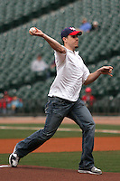 Houston Cougars starting quarterback Case Keenum delivers the ceremonial first pitch against the Texas Tech Red Raiders on Sunday March 7th, 2100 at the Astros College Classic in Houston's Minute Maid Park.  (Photo by Andrew Woolley / Four Seam Images)