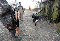 NWA Democrat-Gazette/FLIP PUTTHOFF<br />Magnum brings a duck Feb. 2 2018 to the rear of the duck hunting blind with admiration from Dakota Falcon (center). The dog got a workout during the youth hunt after accurate shooting by the young hunters.