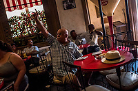 HAVANA, CUBA - SEPTEMBER 08: Cubans and tourists enjoy the atmosphere in La Floridita bar on 8th of September, 2015 in Havana, Cuba. La Floridita most famous for Ernest Hemingway's patronage of the bar daily attracts large numbers of tourists for an experience of Hemingway's Havana. <br /> <br /> Daniel Berehulak for The New York Times