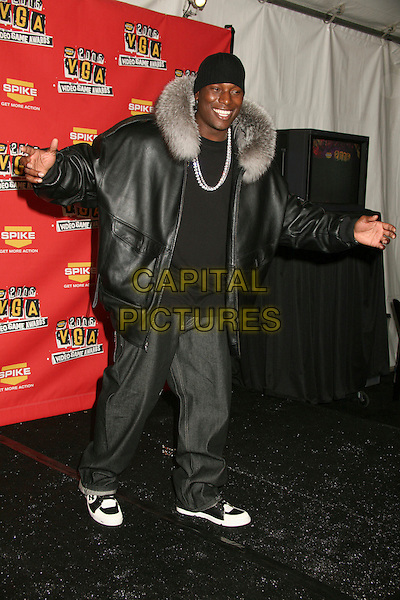 TYRESE GIBSON.Spike TV's 2006 Video Game Awards at the Galen Center - Press Room, Los Angeles, California, USA..December 8th, 2006.full length leather jacket jeans denim arms black hat beanie grey gray fur collar .CAP/ADM/BP.©Byron Purvis/AdMedia/Capital Pictures