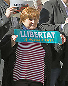 An unidentified woman displays a sign on the street in front of the Palau de la Generalitat de Catalunya as she and others advocate for Catalonian independence from Spain on Tuesday, November 7, 2017. The building is a historic palace in Barcelona, Catalonia, that houses the offices of the Presidency of the Generalitat de Catalunya Barcelona. <br /> Credit: Ron Sachs / CNP