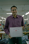 The Deputy Director of Banga Garment Ltd showing the lettre of gratitude received from H&M, Dhaka