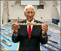 BNPS.co.uk (01202 558833)Pic: LeeMcLean/BNPS<br /> <br /> The wooden frame for Philip Warren's matchstick fleet.<br /> <br /> Master modeller Philip Warren has spent 70 years building an incredible fleet of 484 warships and he says he is not ready to sail into the sunset.<br /> <br /> Philip, 87, has dedicated his entire adult life to crafting the matchstick armada and has built every class of ship in the Royal Navy since 1945, using over a million matchsticks.<br /> <br /> He recently completed a magnificent 3ft replica of the HMS Queen Elizabeth aircraft carrier which took him eight months.