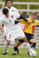 The MetroStars' Sergio Galvan Rey battles  Craig Capano of the Fire for the ball. The MetroStars defeated the Chicago Fire 2-0 during the inaugural Hall of Fame game on Monday October 11, 2004 at At-A-Glance Field at the National Soccer Hall of Fame and Museum, Oneonta, NY..