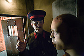 Oleg Kalmikov, a researcher at the Gulag Museum in Moscow, plays a prison guard with an exhibit.