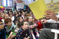 NWA Democrat-Gazette/CHARLIE KAIJO U.S. Rep. Steve Womack (right) reads to 1st graders, Friday, March 2, 2018 at Bellview Elementary School in Rogers.<br />