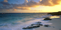 Anguilla, BWI<br /> Caribbean sunrise over the Atlantic Ocean with reflections on a pocket beach near Island Harbor