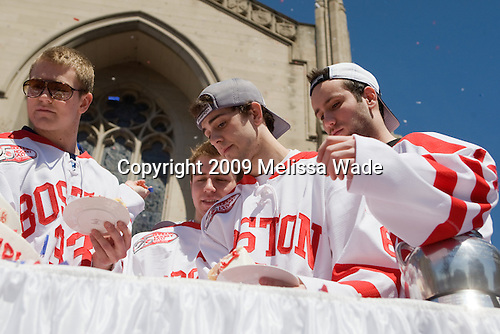 Colin Wilson (BU - 33), David Warsofsky (BU - 5), Joe Pereira (BU - 6), Andrew Glass (BU - 14) - Boston University celebrated the Terrier's men's hockey national championship win with a parade starting from a parking lot at Commonwealth Avenue and Deerfield running to BU's Marsh Plaza where the Terriers were honored on stage before mingling with the fans.