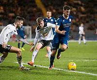 10th March 2020; Dens Park, Dundee, Scotland; Scottish Championship Football, Dundee FC versus Ayr United; Shaun Byrne of Dundee strides past Luke McCowan and Daniel Harvie of Ayr United