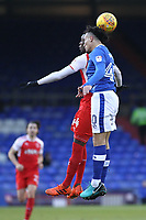 Fleetwood Town's Devante Cole (left)  battles with Oldham Athletic's Kean Bryan (right) during the Sky Bet League 1 match between Oldham Athletic and Fleetwood Town at Boundary Park, Oldham, England on 26 December 2017. Photo by Juel Miah / PRiME Media Images.