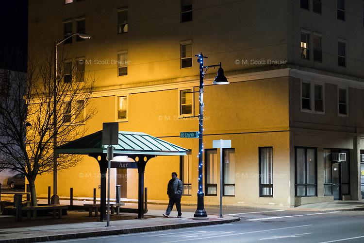 A man walks along Main Street in downtown Brockton, Massachusetts, USA, on Wed., March 29, 2017.