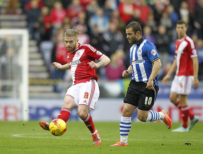 Middlesbrough's Adam Clinton battles with  Wigan Athletic's Shaun Maloney<br /> <br /> Photographer Mick Walker/CameraSport<br /> <br /> Football - The Football League Sky Bet Championship - Wigan Athletic v Middlesbrough - Saturday 22nd November 2014 - DW Stadium - Wigan<br /> <br /> &copy; CameraSport - 43 Linden Ave. Countesthorpe. Leicester. England. LE8 5PG - Tel: +44 (0) 116 277 4147 - admin@camerasport.com - www.camerasport.com