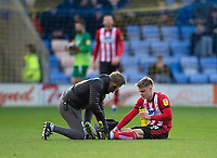 Lincoln City's Jake Hesketh receives treatment from Lincoln City's head of sports science and medicine Mike Hine<br /> <br /> Photographer Andrew Vaughan/CameraSport<br /> <br /> The EFL Sky Bet League One - Shrewsbury Town v Lincoln City - Saturday 11th January 2020 - New Meadow - Shrewsbury<br /> <br /> World Copyright © 2020 CameraSport. All rights reserved. 43 Linden Ave. Countesthorpe. Leicester. England. LE8 5PG - Tel: +44 (0) 116 277 4147 - admin@camerasport.com - www.camerasport.com