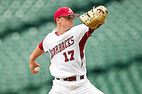 Barrett Astin #17 of the Arkansas Razorbacks in action against the Texas Tech Red Raiders at Minute Maid Park on March 2, 2012 in Houston, Texas.  The Razorbacks defeated the Red Raiders 3-1.  Brian Westerholt / Four Seam Images