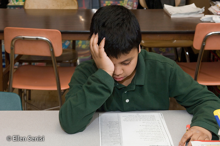 MR / Schenectady, NY.Yates Arts-in-Education Magnet School (urban public elementary school).Self-Contained Special Education Class - but students also mainstreamed several hours a day..Boy (9) working on reading worksheet is discouraged..MR: Mar21.© Ellen B. Senisi