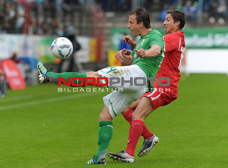 26.07.2011, MEP Arena, Meppen, GER, FSP, Werder Bremen vs Olympiakos Pir&auml;us, im Bild Philipp Bargfrede (Bremen #44), David Fuster (Piraeus #19)<br /> <br /> // during friendly match Werder Bremen vs Olympiakos Pir&auml;us on 2011/07/26,  MEP Arena, Meppen, Germany.<br /> Foto &copy; nph / Frisch