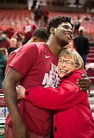 NWA Democrat-Gazette/CHARLIE KAIJO Arkansas Razorbacks guard Jaylen Barford (left) hugs Mary Ella Earle of Fayetteville during an NCAA selection show, Sunday, March 11, 2018 at Bud Walton Arena in Fayetteville. The Razorbacks will play Butler in Detroit on Friday