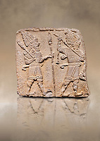 Aslantepe Hittite relief sculpted orthostat stone panel. Limestone, Aslantepe, Malatya, 1200-700 B.C. Anatolian Civilisations Museum, Ankara, Turkey. Scene of two Gods walking one carrying a spear, dressed in tunics.<br /> <br /> Against a brown art background.