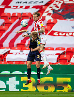 4th July 2020; Bet365 Stadium, Stoke, Staffordshire, England; English Championship Football, Stoke City versus Barnsley; Kilian Ludewig of Barnsley and James McClean of Stoke City jump for the ball