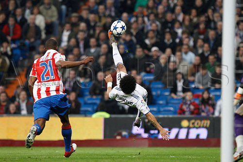 13.01.2011 Spanish Copa del Rey from the Santiago Bernebeu. Real Madrid vs At. Madrid 3-1. Picture shows  Marcelo in action during the match with an overhead kick...
