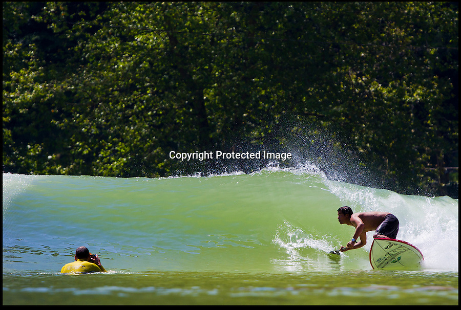 BNPS.co.uk (01202 558833)<br /> Pic: Wavegarden/BNPS<br /> <br /> ***Please use full byline***<br /> <br /> Surfers will soon be able to ride waves without the need for beaches or the ocean thanks to a revolutionary 'wave garden' set to debut in the UK.<br /> <br /> The six million pounds surfing lake, the world's first public wave pool of its kind, uses cutting edge technology to fire perfectly formed waves along a 1,000ft man-made lagoon.<br /> <br /> Normally, surfers are forced to wait for waves to be formed by the right weather conditions - a rare occurrence around British shores.<br /> <br /> But the new open-air attraction, dubbed The Wave, will offer the chance to enjoy guaranteed rides of up to 20 seconds long on peeling waves as tall as 5ft.<br /> <br /> It will shoot out 120 waves per hour - two every minute - either side of a central pier and will aim to stay open for 10 months of the year.<br /> <br /> There will be seperate areas for beginners, and one hour's surfing will cost around £15.<br /> <br /> The first site has been earmarked to open near Bristol in summer 2014, with more UK sites planned including one on the Isle of Wight.
